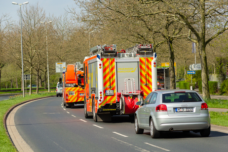 HANNOVER / GERMANY - APRIL 18, 2018: German fire service vehicles from the professional fire department drive to a deployment site.