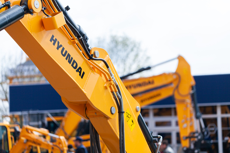 Photo for MUNICH / GERMANY - APRIL 14, 2019: Hyundai logo on a digger arm at a Hyundai machine dealer. - Royalty Free Image