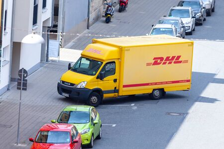 Photo for FUERTH / GERMANY - JULY 20, 2019: Iveco transporter from international courier, parcel, and express mail company DHL, stands on a street. - Royalty Free Image