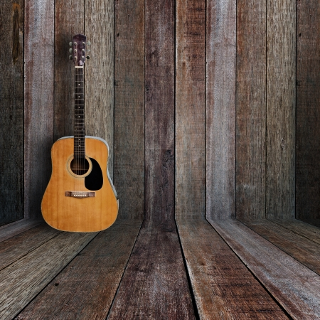 Photo pour Guitar in vintage wood room. - image libre de droit