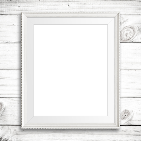 Photo for White picture frame on white wood wall. - Royalty Free Image