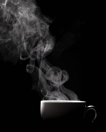 Photo pour Steaming coffee in cup isolated on black background with copy space. - image libre de droit