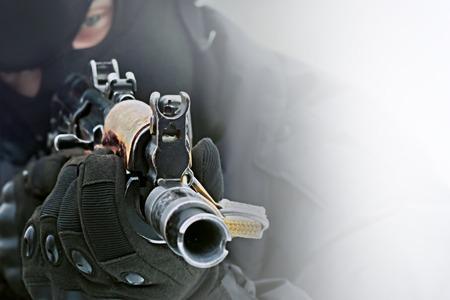 Gun in the hands of the killer