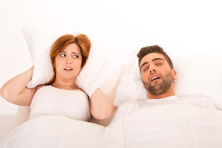 Portrait of an annoyed woman awaken by her fiance's snoring