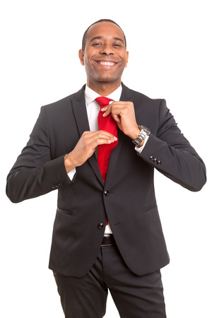 African business man fixing his tie, siolated over white