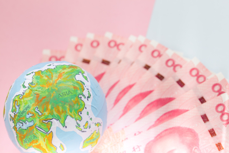 handmade globe on chinese banknotes, business and finance concepts