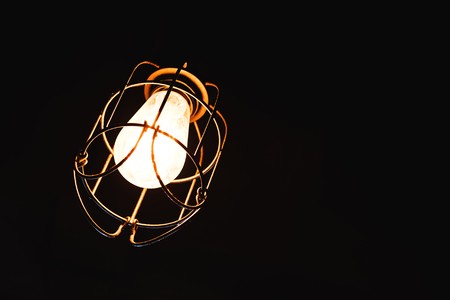 isolated vintage lamp hanging from ceiling
