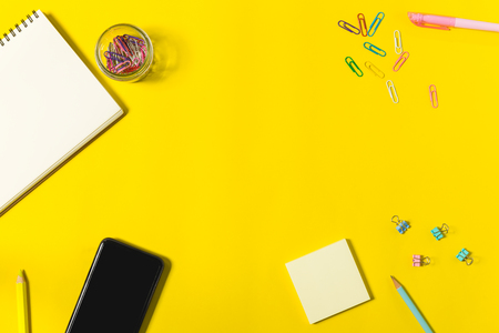 Photo pour flat lay stationary on yellow background with copy space, office and education concept - image libre de droit