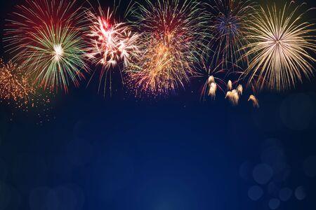 Photo pour colorful fireworks on dark blue bokeh background, celebration concept - image libre de droit