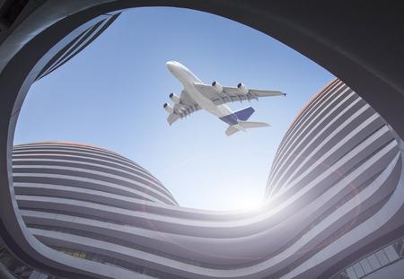 Photo pour Modern glass building, plane above - image libre de droit