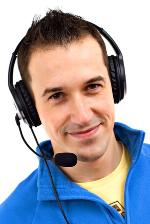 Young friendly man with headset on white background