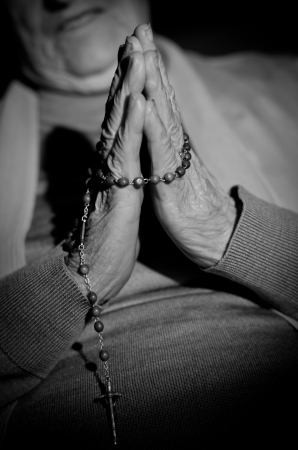 a close up view of praying hands