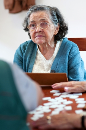Senior people playing rummy togetherの写真素材