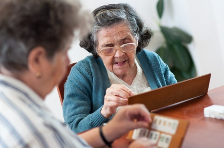 Senior people playing rummy gameの写真素材