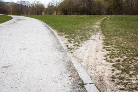 Photo pour Diverging Path Sidewalk Dirth Path Grass Outdoors Decision Road Less Traveled - image libre de droit