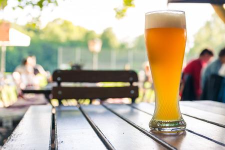 Foto de German Beer 0,5 Liter on Wooden Table Biergarten Traditional Culture Beautiful Day - Imagen libre de derechos