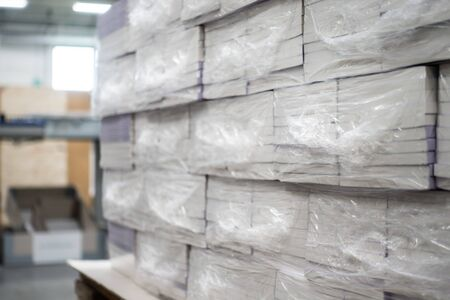 Photo pour Heat Shrink Wrapped Books Awaiting Delivery Industrial Production Automated Packaging Machinery - image libre de droit