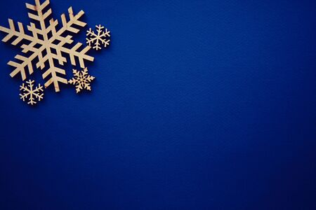 Photo for Blue winter holiday background with handmade wooden snowflake.Paper backdrop with hand crafted snow flake figure made from rustic wood material.Christmas wallpaper with empty space for text - Royalty Free Image