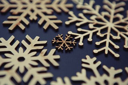 Photo for Rustic wooden snowflakes for Christmas Eve celebration.Hand made crafts for New Year home decor.Decorate house with eco friendly materials for winter holidays - Royalty Free Image