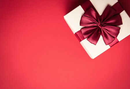 Photo for Flat lay Christmas background with gift box shot from above.New Year presents packed in decorative package.Wallpaper with empty space for text.Beautiful handmade present for winter holidays - Royalty Free Image
