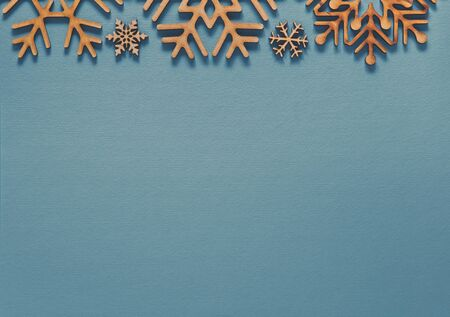 Photo for Flat lay background with rustic snowflakes.Light blue backdrop with handmade wooden toys for winter holiday.Christmas Eve and New Year celebration party poster template with empty space for text - Royalty Free Image