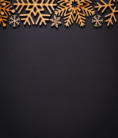 Photo for Black flat lay background with Christmas decorations.Hand crafted snowflakes on dark backdrop.Rustic handmade wallpaper with empty space for text.New Year celebration party poster template - Royalty Free Image