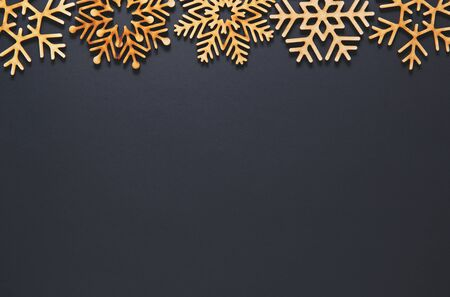 Photo for Black flat lay background.Christmas toys on wallpaper.Handmade wooden decorations for New Year party poster design.Empty space on postcard template for winter holiday celebration party - Royalty Free Image