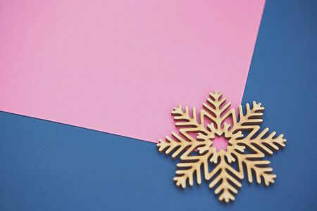 Photo for Flat lay background with handmade wooden snowflake shot from above.Pink and blue colors,empty space for text - Royalty Free Image
