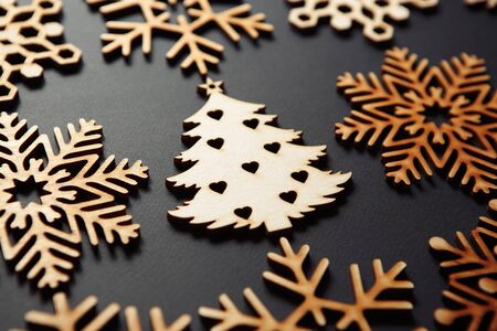 Photo for Rustic Christmas tree toys on black background.Beautiful handmade wooden elements made from ecological material for home decor. - Royalty Free Image