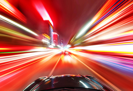 Foto de A car driving on a motorway at high speeds, overtaking other cars - Imagen libre de derechos