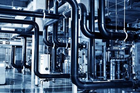 Modern boiler room equipment for heating system. Pipelines, water pump, valves, manometers.