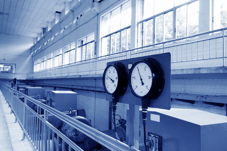 Sewage treatment plants indoors and instrumentation closeup.