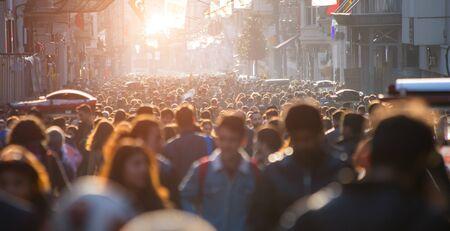 Photo pour Blurred crowd of unrecognizable at the street - image libre de droit