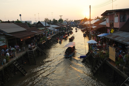 view on amphawa floating market early in the morning with boat sailing in Thailand on 6 February 2010.
