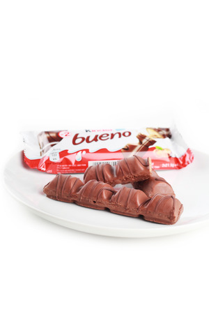 Shah Alam, Malaysia - FEBRUARY 3, 2017. kinder bueno chocolate bar with  a glass of milk isolated in white background  ilustrative editorial