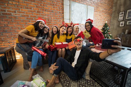 Photo for asian indoor having fun at christmas indoor - Royalty Free Image