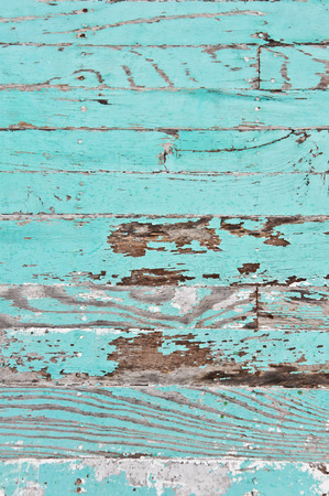 Grungy wooden panels with peeled paint layer