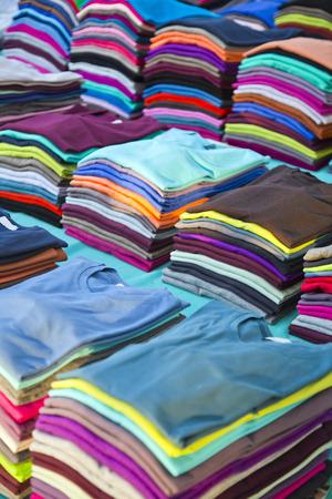 Photo pour Newly out colorful t-shirt piles - image libre de droit