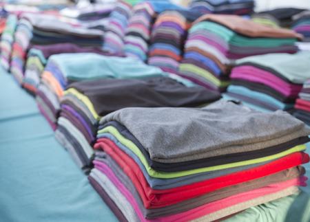 Photo pour Colorful t-shirt piles - image libre de droit