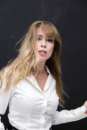 Foto de Beautifully aging blonde lady in white shirt, studio portrait - Imagen libre de derechos