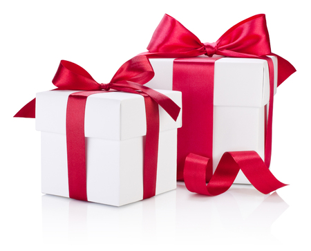 Foto de Two white gift boxes tied burgundy ribbon bow Isolated on white background - Imagen libre de derechos