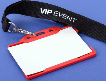 an id badge for a VIP event on a blue background, focuse on the vip text