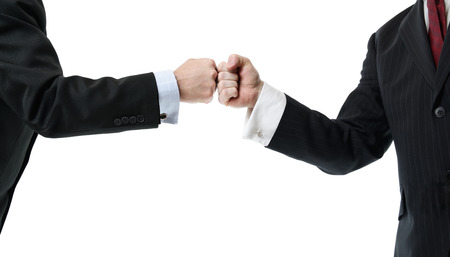 two businessmen greeting with a fist bump isolated on white
