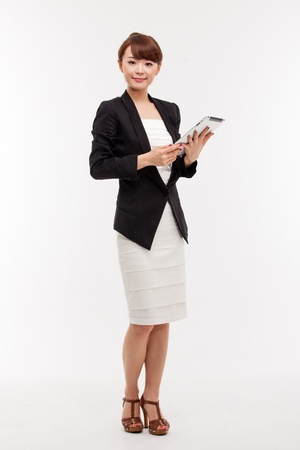 Photo pour Business woman and note book isolated on white background  - image libre de droit