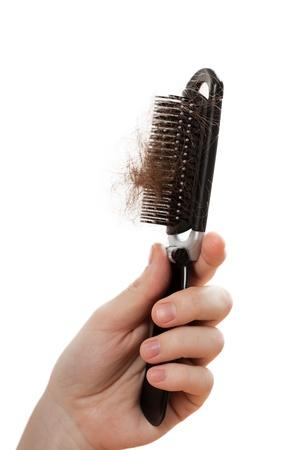 Balding problem women hand holding loss hair comb