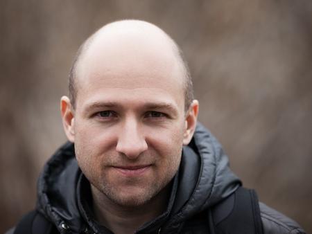 Human alopecia or hair loss - smiling adult man bald head