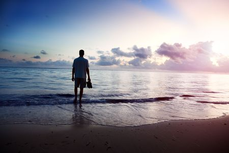 young man and sunset on sea