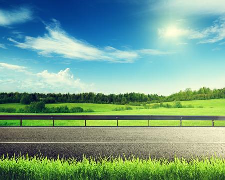 Photo pour road and spring grass - image libre de droit