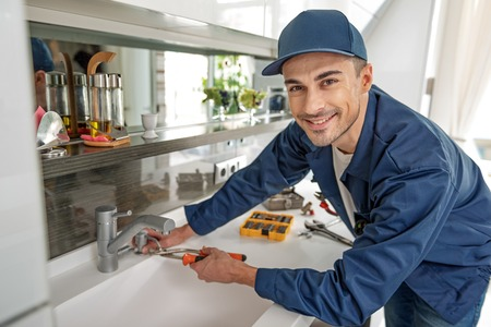 Cheerful male person using tools