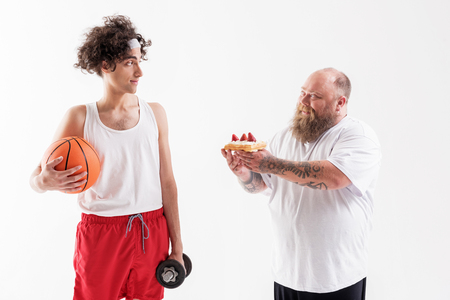 Thick guy seducing thin sportsman by cake